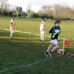 Cian McPhillips crosses the finishing line as Ardagh win gold.
