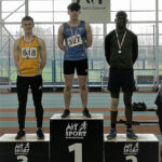 Killian Rawle, Longford AC, showing continued improvement with a time of 7.45 seconds, as he steps onto 1st Place to receive Gold in U18 Boys 60m sprint at the recent Connacht Indoor Championships at AIT International Arena. Also pictured is Richard Kamsen, GCH in 2nd place, time 7.55 seconds and Sean O'Connell, Lake District AC in 3rd place at 7.62 seconds.