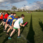 6-Boys'-race-at-the-starting-line-with-batons-in-hand